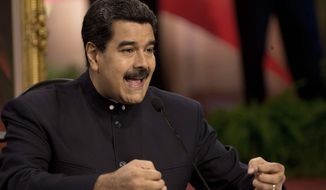 Venezuelan President Nicolas Maduro says he is trying to deal with sharp levels of economic inequality that have long plagued his country. (Associated Press/File)
