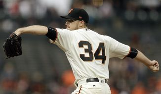 San Francisco Giants pitcher Chris Stratton works against the Milwaukee Brewers in the first inning of a baseball game Monday, Aug. 21, 2017, in San Francisco. (AP Photo/Ben Margot)