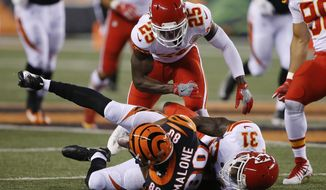 Cincinnati Bengals wide receiver Josh Malone (80) is tackled by Kansas City Chiefs cornerback DeVante Bausby (31) during the second half of an NFL preseason football game, Saturday, Aug. 19, 2017, in Cincinnati. (AP Photo/Gary Landers)