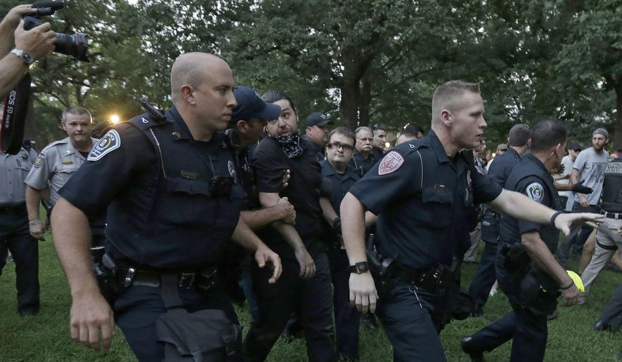 "Police arrest a man during a protest at a Confederate monument at the University of North Carolina in Chapel Hill, N.C., Tuesday, Aug. 22, 2017. The gathering Tuesday night at the university focused on a statue known as ""silent Sam."" People chanted ""tear it down"" while uniformed officers watched from behind temporary metal barriers ringing the statue, depicting a Confederate soldier. (AP Photo/Gerry Broome) ** FILE **"