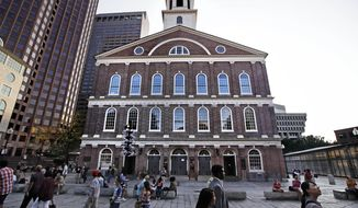 "Pedestrians pass Faneuil Hall, also known as ""the Cradle of Liberty"" in Boston, Monday, Aug. 21, 2017. As U.S. cities grapple with what to do with Confederate monuments, a movement is afoot to rename the historic hall, where the earliest calls for independence from Britain were sounded in the late 1700s. It was named for Peter Faneuil, a merchant who owned and traded slaves. (AP Photo/Charles Krupa)"