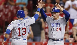 Chicago Cubs' Anthony Rizzo (44) and Alex Avila (13) celebrate scoring on a single by Javier Baez off Cincinnati Reds relief pitcher Wandy Peralta during the seventh inning of a baseball game, Tuesday, Aug. 22, 2017, in Cincinnati. (AP Photo/John Minchillo)