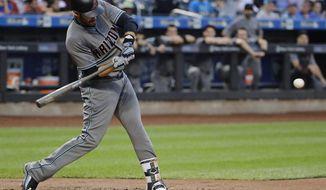 Arizona Diamondbacks' J.D. Martinez hits a three-run home run during the first inning of a baseball game against the New York Mets, Tuesday, Aug. 22, 2017, in New York. (AP Photo/Frank Franklin II)