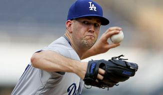 Los Angeles Dodgers starter Alex Wood inning pitches against the Pittsburgh Pirates in the first inning of a baseball game, Monday, Aug. 21, 2017, in Pittsburgh. (AP Photo/Keith Srakocic)
