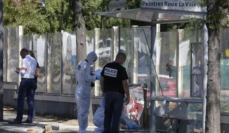Policce officers inspect a bus stop in La Valentine district after a van rammed into two bus stops in the French port city of Marseille, southern France, Monday Aug.21, 2017. At least one person was killed. (AP Photo/Claude Paris)