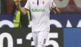 """FILE - In this Feb. 19, 2017 file photo Fiorentina's Nikola Kalinic celebrates after scoring during a Serie A soccer match between AC Milan and Fiorentina, at the San Siro stadium in Milan, Italy. In a brief statement on Tuesday, Aug. 22, 2017 AC Milan said it is """"delighted to announce the signing of Nikola Kalinic from Fiorentina ACF on a loan deal with obligation to buy."""" (AP Photo/Antonio Calanni, file)"""