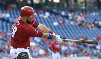 Philadelphia Phillies' Cameron Rupp follows through after hitting solo home run off Miami Marlins' Dan Straily during the fifth inning of the first baseball game in a doubleheader, Tuesday, Aug. 22, 2017, in Philadelphia. (AP Photo/Derik Hamilton)