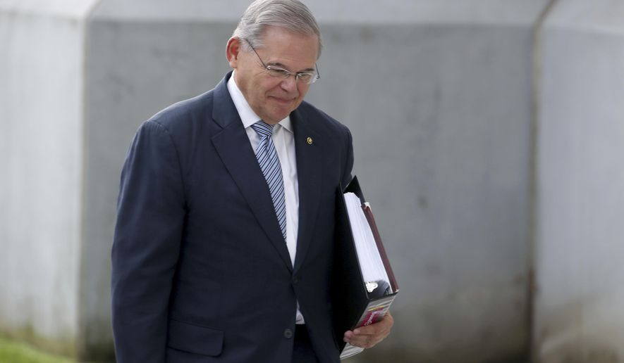 U.S. Sen. Bob Menendez arrives at the federal courthouse for jury selection for his corruption trial next month in Newark on Tuesday, Aug. 22, 2017.  . Menendez was charged in 2015 with accepting gifts and campaign donations from a Florida eye doctor in exchange for using his position in Congress to lobby for the man's business interests.  (Ed Murray/NJ Advance Media via AP)