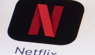 FILE - This Monday, July 17, 2017, file photo shows the Netflix logo on an iPhone in Philadelphia. Much of the attention showered on Netflix focuses on its insatiable appetite for original content. But this streaming network's multi-billion-dollar annual outlay for new programming necessitates another challenge: Matching each program with the subscribers who are likely to enjoy it. Netflix tags content, then identifies viewer habits. (AP Photo/Matt Rourke, File)