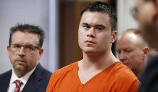 FILE - In this Jan. 21, 2016, file photo, former Oklahoma City police officer Daniel Holtzclaw, center, and his attorney Scott Adams are seen at a sentencing hearing in Oklahoma City. Holtzclaw's conviction and 263-year prison sentence for rape and other sex crimes are coming under increased scrutiny as questions are raised about DNA evidence amid a series of sealed court filings and secret hearings. Holtzclaw is appealing the conviction. (AP Photo/Sue Ogrocki, Pool, File)