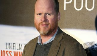 """FILE - This Jan. 21, 2014, file photo shows American film producer and director Joss Whedon at the screening of """"Much Ado About Nothing"""" in Paris. Whedon's ex-wife Kai Cole alleged in an essay published by The Wrap on Aug. 20, 2017, that Whedon had multiple affairs during their 16-year marriage. (AP Photo/Remy de la Mauviniere, File)"""