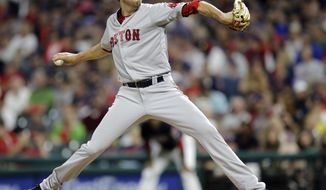 Boston Red Sox starting pitcher Doug Fister delivers in the first inning of a baseball game against the Cleveland Indians, Tuesday, Aug. 22, 2017, in Cleveland. (AP Photo/Tony Dejak)