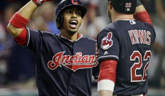 Cleveland Indians' Francisco Lindor, left, is congratulated by Jason Kipnis after Lindor hit a solo home run off Boston Red Sox starting pitcher Doug Fister in the first inning of a baseball game, Tuesday, Aug. 22, 2017, in Cleveland. (AP Photo/Tony Dejak)