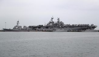 The USS John S. McCain, left, is docked next to USS America at Singapore's Changi naval base on Tuesday, Aug. 22, 2017, in Singapore. (AP Photo/Wong Maye-E) ** FILE **