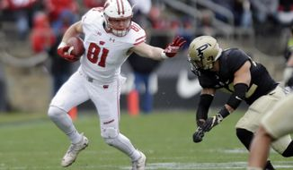 File-This Nov. 19, 2016, file photo shows Wisconsin tight end Troy Fumagalli (81) trying to get past Purdue linebacker Andy James Garcia (42) during the first half of an NCAA college football game in West Lafayette, Ind. Fumagalli was named to the second team AP Preseason All-America Team on Tuesday, Aug. 22, 2017.   (AP Photo/Michael Conroy, File)