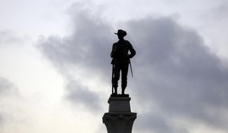 A Confederate Soldier Statue stands tall on the Texas Brigade monument on the east side of the Texas State Capitol in Austin, Texas, Aug. 21, 2017. (AP Photo/Eric Gay)  ** FILE **