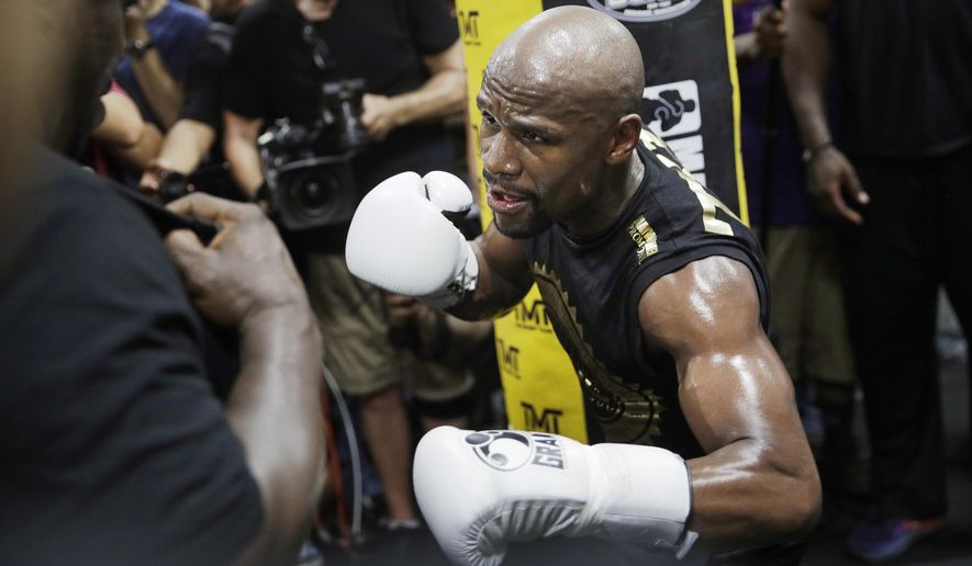 File- This Aug. 10, 2017, file photo shows Floyd Mayweather Jr. training at his gym in Las Vegas. Look at any boxing website, and the comments will largely all be the same. Mayweather Jr.'s fight with Conor McGregor is a joke, a spectacle that has little to do with real boxing. No reason to spend two cents on it, much less $100, when there's a real super fight coming up a few weeks later between Gennady Golovkin and Canelo Alvarez. (AP Photo/John Locher, File)