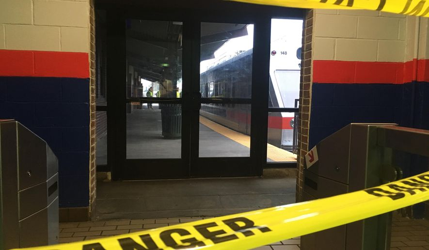 Police tape blocks off a train track at the 69th Street Terminal in Upper Darby, Pa., after a train collision early Tuesday, Aug. 22, 2017, injuring dozens of passengers. A regional rail train crashed into a parked train at the suburban Philadelphia terminal, a regional rail spokeswoman said. (AP Photo/Anthony Izaguirre)