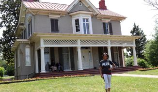 "This June 15, 2017 photo shows gymnast and Olympic gold medalist Dominique Dawes visiting the Frederick Douglass house in Washington, D.C., as an ambassador for the National Park Service. The National Park Service is marking its 101st birthday amid a ""Parks 101"" campaign enlisting celebrities, actors, athletes and others to help publicize sites that get less visitation than the big parks like Yellowstone and the Grand Canyon. (Ryan Hallett/National Park Foundation via AP)"