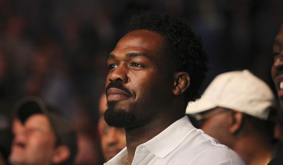 FILE - In this April 9, 2017, file photo, mixed martial arts fighter Jon Jones watches a bout at UFC 210 in Buffalo, N.Y. Light heavyweight champion Jones has been notified of another potential violation of the UFC's anti-doping policy. The UFC announced the potential violation Tuesday night, Aug. 22, for Jones, widely considered the top pound-for-pound fighter in mixed martial arts. (AP Photo/Jeffrey T. Barnes, File) **FILE**