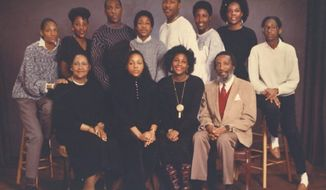 Dick Gregory (seated right) influenced not only his family's education but the entire civil rights struggle. (Dick Gregory family)