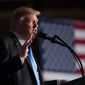 President Trump continued his role as an outsider in the White House when he held a rally in Arizona on Tuesday. (Associated Press)
