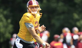 Washington Redskins quarterback Nate Sudfeld (2) follows the ball during practice at the team's NFL football training facility at Redskins Park in Ashburn, Va., ., Wednesday, Aug. 23, 2017. (AP Photo/Manuel Balce Ceneta)