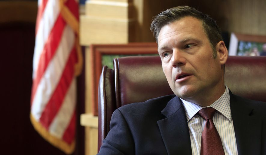 Kansas Secretary of State Kris Kobach talks with a reporter in his office in Topeka. Kobach, co-chairman of President Donald Trump's Presidential Advisory Commission on Election Integrity who is promoting Trump's unsubstantiated claims of widespread voter fraud, oversees a Kansas election system that threw out at least three times as many ballots as similarly sized states did. That is fueling concerns about massive voter suppression should its practices become the national standard. (AP Photo/Orlin Wagner, File)
