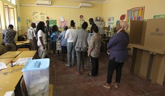 Voters queue to cast their votes at a polling station in presidential elections in Luanda, Wednesday, Aug. 23, 2017. Defense Minister, Joao Lourenco, is the front-runner to succeed President Jose Eduardo dos Santos, who will step down after 38 years in power in an oil-rich country. (AP Photo/Bruno Fonseca)