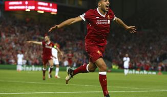 Liverpool's Emre Can celebrates scoring his sides first goal during the Champions League qualifying play-off second leg soccer match between Liverpool and Hoffenheim at Anfield stadium in Liverpool, England, Wednesday, Aug. 23, 2017. (AP Photo/Dave Thompson)