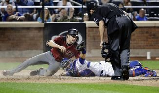 New York Mets catcher Travis d'Arnaud (18) shows the umpire the ball after tagging out Arizona Diamondbacks' A.J. Pollock (11) at home plate for a double play during the fifth inning of a baseball game Wednesday, Aug. 23, 2017, in New York. (AP Photo/Frank Franklin II)