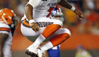 Cleveland Browns quarterback DeShone Kizer celebrates after a 1-yard touchdown in the first half of an NFL preseason football game against the New York Giants, Monday, Aug. 21, 2017, in Cleveland. (AP Photo/Ron Schwane)