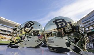FILE - In this Dec. 5, 2015, file photo, Baylor helmets on shown the field after an NCAA college football game in Waco, Texas. For more than a year, the federal civil lawsuits against Baylor have piled in and piled on, accusing the nation's largest Baptist school of mishandling, ignoring or stifling claims of sexual and physical abuse of students for years. After months of bad publicity, the firing of a popular football coach and demotion and departure of a school president, Baylor is starting to make those cases go away with settlements as evidence gathering is just heating up and well before any of them approach trial. (AP Photo/LM Otero, File)