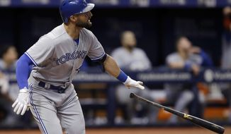 Toronto Blue Jays' Kevin Pillar watches his home run off Tampa Bay Rays relief pitcher Tommy Hunter during the eighth inning of a baseball game Wednesday, Aug. 23, 2017, in St. Petersburg, Fla. (AP Photo/Chris O'Meara)