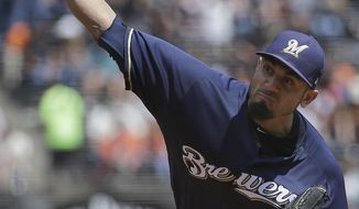 Milwaukee Brewers pitcher Matt Garza throws against the San Francisco Giants during the second inning of a baseball game in San Francisco, Wednesday, Aug. 23, 2017. (AP Photo/Jeff Chiu)