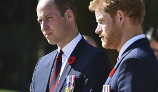 FILE - This is a Sunday, April 9, 2017, file photo of Britain's Prince William,  left, and Britain's Prince Harry as they arrive at the Canadian National Vimy Memorial in Vimy, near Arras, northern France, to attend the commemorations of the 100th anniversary of the Battle of Vimy Ridge. Princes William and Harry have spoken candidly about the death of their mother, Princess Diana, in an interview marking 20 years since she was killed in a car crash.  (Philippe Huguen/Pool Photo, File via AP)
