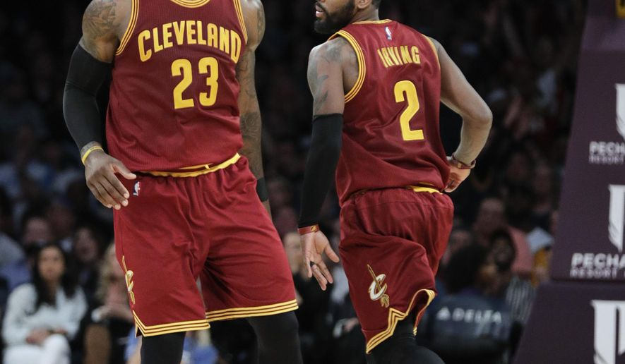 FILE - In this March 19,  2017, file photo, Cleveland Cavaliers' LeBron James, left, greets Kyrie Irving during the second half of an NBA basketball game against the Los Angeles Lakers in Los Angeles. Irving was tired of being teammates with James. Now he has to figure out how to beat him. Cleveland's All-Star guard, who asked team owner Dan Gilbert to trade him earlier this summer, was dealt Tuesday night, Aug. 22, to the Boston Celtics for fellow All-Star Isaiah Thomas, forward Jae Crowder, center Ante Zizic and the Brooklyn Nets' unprotected 2018 first-round draft pick. (AP Photo/Jae C. Hong, File)