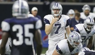 In this Tuesday, Aug. 22, 2017 photo, Dallas Cowboys quarterback Cooper Rush (7) calls a play from the line during an NFL football camp practice in Frisco, Texas. Undrafted quarterback Cooper Rush is leaving the same preseason impression Dak Prescott did as a rookie a year ago. Rush isn't going to replace a healthy Prescott, but he's already taking second-team reps from veteran Kellen Moore. (AP Photo/LM Otero)