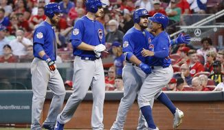 Chicago Cubs' Kyle Schwarber, center right, celebrates with Jon Jay, right, Mike Montgomery, center left, and Ben Zobrist after hitting a three-run home run off Cincinnati Reds starting pitcher Asher Wojciechowski during the fourth inning of a baseball game, Wednesday, Aug. 23, 2017, in Cincinnati. (AP Photo/John Minchillo)