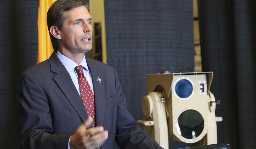 U.S. Sen. Martin Heinrich, D-New Mexico, discusses the potential of high-energy laser weapons systems being developed by engineers at Boeing during a news conference in Albuquerque, N.M., on Wednesday, Aug. 23, 2017. Heinrich said the U.S. Defense Department is investing $17 million as part of an effort to transfer the technology from the lab to the battlefield. (AP Photo/Susan Montoya Bryan)