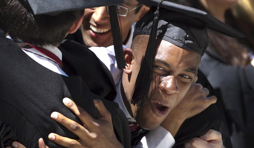 FILE - In this May 24, 2012 file photo, Harvard University Arts and Sciences graduates react as degrees are conferred during commencement exercises on the school's campus in Cambridge, Mass. According to a report released Wednesday, Aug. 23, 2017, by the independent Massachusetts Budget and Policy Center, half of all workers in Massachusetts held a bachelor's degree or higher in 2016, marking the first time a U.S. state has reached that threshold. (AP Photo/Steven Senne File)