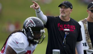 File-This Aug. 2, 2017, file photo shows Atlanta Falcons head coach Dan Quinn during the team's NFL training camp football practice in Flowery Branch, Ga. Quinn is still weighing whether to let All-Pro receiver Julio Jones play in the exhibition home opener at the team's new stadium. Quinn says Pro Bowl running back Devonta Freeman is still in the concussion protocol and likely won't play until Atlanta's season begins Sept. 10 at Chicago. (AP Photo/John Bazemore, File)