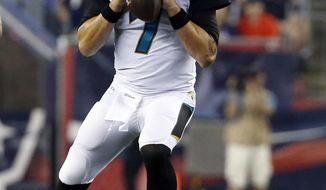 File-This Aug. 10, 2017, file photo shows Jacksonville Jaguars quarterback Chad Henne looking for a receiver in the first half of an NFL preseason football game against the New England Patriots, in Foxborough, Mass.  The Jaguars name a starting quarterback for their preseason game against Carolina, and all indications are it will be Henne. (AP Photo/Mary Schwalm, File)