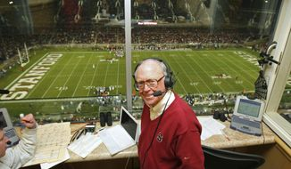 In this Dec. 1, 2007 photo provided by Stanford Athletics, sports broadcaster Bob Murphy poses during Stanford's football game against California at Stanford Stadium in Stanford, Calif. Murphy, the longtime voice of Stanford University sports who brought a folksy sense of community to his commentary for more than four decades, has died. He was 86. Murphy died Tuesday, Aug. 22, 2017, in Santa Cruz, Calif., of complications from Alzheimer's disease. The school said in a statement that he had the disease for several years. (Kyle Terada/Stanford Athletics via AP)