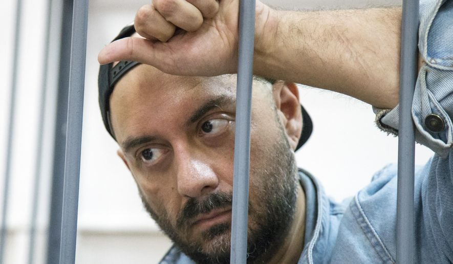Russia's theater and film director Kirill Serebrennikov waits for hearings in a court in Moscow, Russia, Wednesday, Aug. 23, 2017. Serebrennikov is accused of embezzling 68 million rubles ($1.1 million) of government funds that were earmarked for a production at his theater, the Investigative Committee, which looks into high-profile crimes, said in a statement. (AP Photo/Alexander Zemlianichenko)