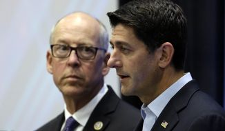 House Speaker Paul Ryan, right, is joined by Rep. Greg Walden, R-Ore., while speaking during a visit to Intel in Hillsboro, Ore., Wednesday, Aug. 23, 2017. Ryan used his visit to the technology giant to talk about tax reform. (AP Photo/Don Ryan).