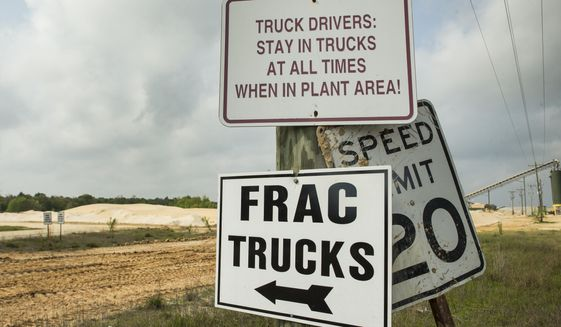 A sign pointing the way to a sand loading site at the Superior Silica Sands sand mine is shown on Tuesday, March 28, 2017, in Kosse, Texas. Demand for sand is surging as oil and gas production in the Permian Basin is booming again. Not only is the need for more sand on the rise with the increase in oil and gas production in west Texas, but much more sand is being pumped into each well now with the emerging thesis that more sand equals more oil extracted.  ( Brett Coomer /Houston Chronicle via AP)