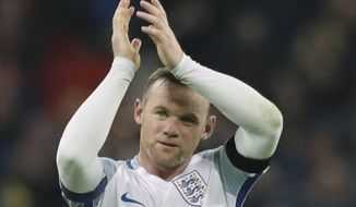 FILE - This is a Friday, Nov. 11, 2016  file photo of England's Wayne Rooney as he claps after winning the World Cup group F qualifying soccer match between England and Scotland with a 3-0 score at the Wembley stadium, London. England striker Wayne Rooney announced his immediate retirement from international football on Wednesday Aug. 23, 2017. (AP Photo/Matt Dunham/File)