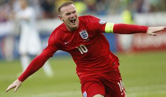 FILE - This is a Sunday, June 14, 2015 file photo of England's Wayne Rooney as he  celebrates his goal during the Euro 2016 Group E qualifying soccer match between Slovenia and England, in Ljubljana, Slovenia. England striker Wayne Rooney announced his immediate retirement from international football on Wednesday Aug. 23, 2017.  (AP Photo/Darko Bandic/File)
