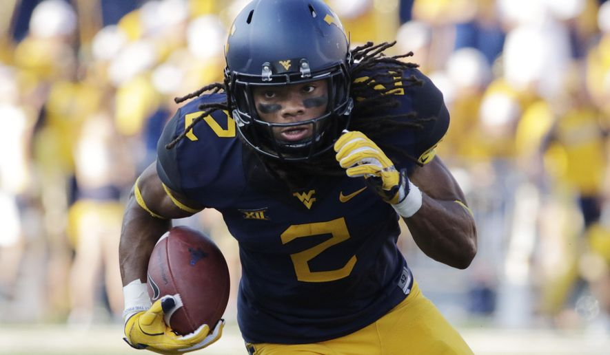 File-This Sept. 10, 2016, file photo shows West Virginia wide receiver Ka'Raun White (2) during an NCAA college football game in Morgantown, W.Va. With the top two wide receivers gone from last year's team, the Mountaineers are hoping that White takes over perhaps the same way his brother, current Chicago Bears receiver Kevin White, did in a big way in his senior season with West Virginia in 2014. (AP Photo/Raymond Thompson, File)